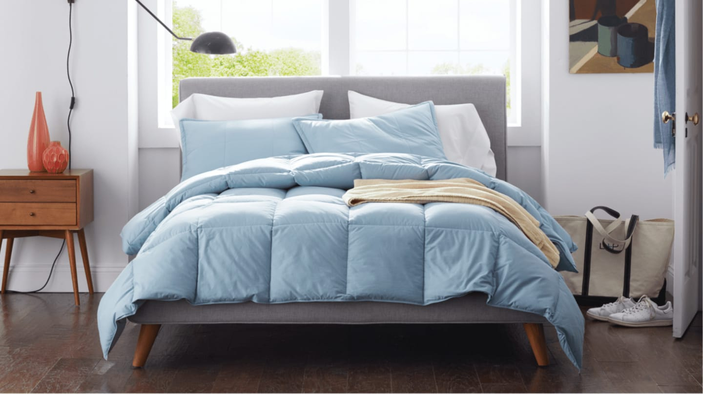 Beautifully styled LaCrosse™ Down Comforter in Porcelain Blue
