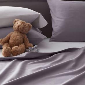 Cute stuffed bear on Legends Luxury™ Velvet Flannel Bedding
