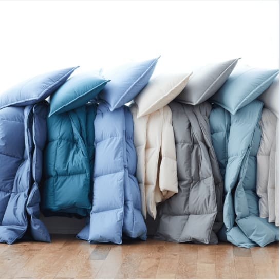 Multiple LaCrosse™ Comforters in shades of blue