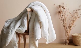 comforter draped over chair