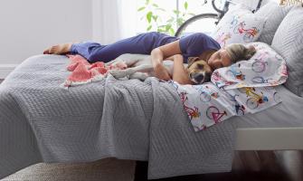 woman sleeping on comforter