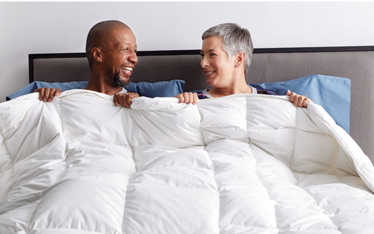 Couple in Bed with Comforter