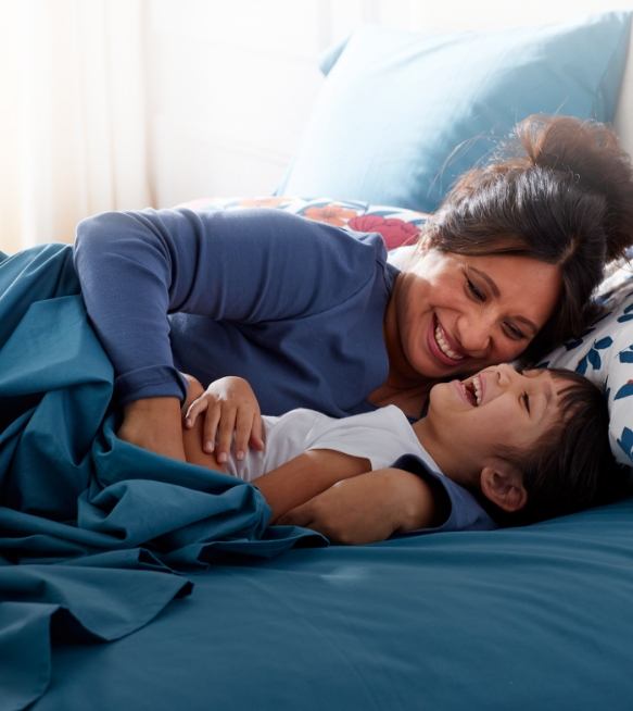 Friends and Family Event - mother and child laying on bed