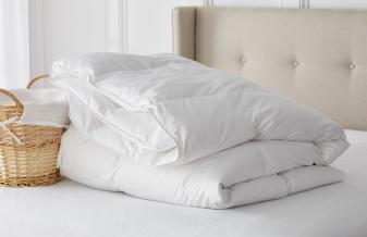 comforter folded on bed